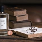 Photo of James Joyce Gin, books, and vintage spectacles